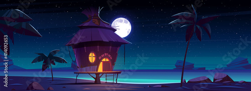 Fotografie, Tablou Beach hut or bungalow at night on tropical island, summer shack with glow window