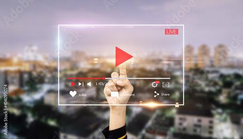 Fototapeta Live video marketing concept.Hands man push start button on touch screen to run video clip obraz