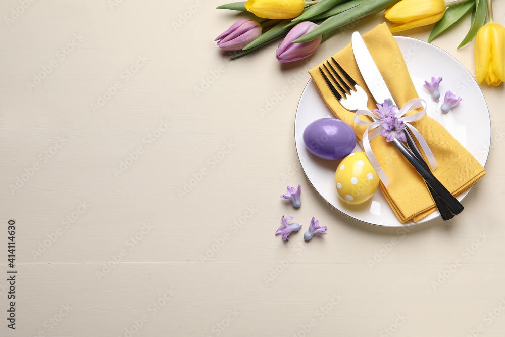 Fototapeta Festive Easter table setting with eggs on beige background, flat lay. Space for text