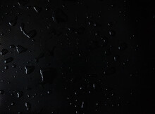 Water Drops On A Black Background
