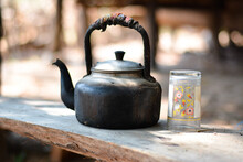 Old Teapot On A Table