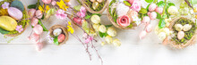 Happy Easter Background With Nests Decoration, Colorful Eggs And Spring Flowers. Caster Card On Sunny Spring Background