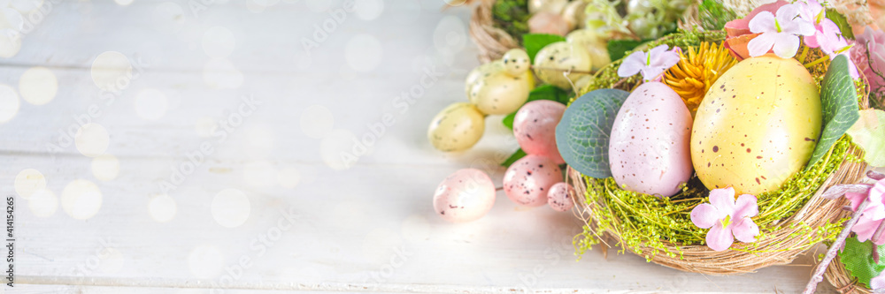 Fototapeta Happy easter background with Nests decoration, colorful eggs and Spring Flowers. Caster card on sunny spring background