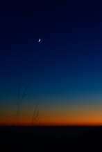 Tiny Crescent Moon In The Blue Sky Just After Sunset