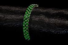 Isolated Emerald Bracelet On A Black Background