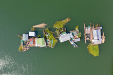 Floating Local Fishing Village Houseboats With Fish Farms Aerial View