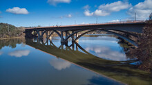 Aerial View Of Bridge With Reflections In The Water