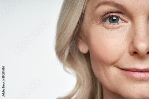 Fotografering 50s middle aged old woman looking at camera isolated on white background advertising dry skin care treatment anti age skincare beauty, plastic surgery, cosmetology procedures