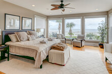 Luxury Beach View Bedroom Looking Out Onto Palm Trees And The Ocean.
