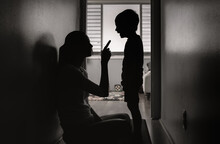 Mother Correcting, Disciplining Her Child For Bad Behavior. Parenting And Discipline Concept,