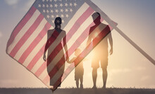 Patriotic Family Walking Together On American Flag Background. American Life Concept.