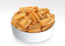 Closeup Shot Of Crispy And Crunchy Salty Wheat Cross-shaped Snacks In A White Bowl