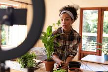 Caucasian Woman, Vlogging, Potting Plants At Home