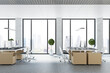 Openspace sunny office with big windows, eco style furniture and concrete columns
