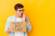 Young Caucasian Man Holding A Protect Our Planet Placard Isolated Is Saying A Secret Hot Braking News And Looking Aside