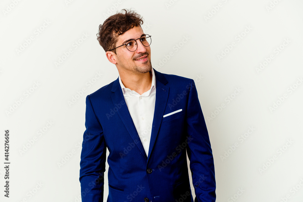 Fototapeta Young business caucasian man isolated on white background relaxed and happy laughing, neck stretched showing teeth.