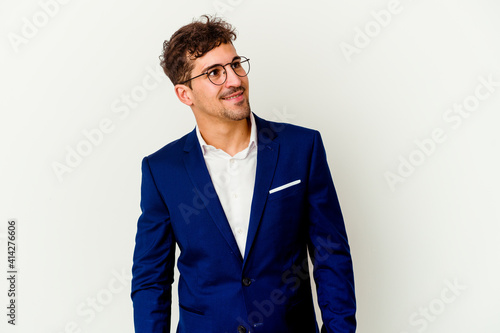 Obraz Young business caucasian man isolated on white background relaxed and happy laughing, neck stretched showing teeth. - fototapety do salonu