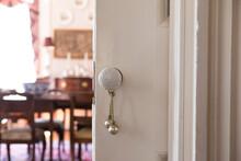 Detail Shot Of Antique Knob On Pocket Door In Historic House.