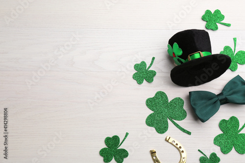 Fotografie, Obraz Flat lay composition with leprechaun hat on white wooden table, space for text