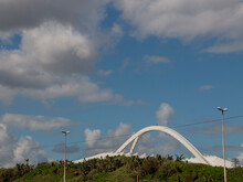 Arch Of The Moses Mabhida Stadium Against Cloudy Sky