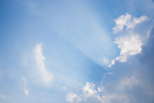 Blue Sky And Clouds With Crepuscular Rays