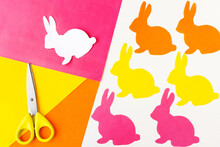 Easter Decoration Made By Your Own Hands. Cut Out Figures Of Rabbits From Colored Paper. DIY Concept. Step By Step Photo Instruction. Step 2