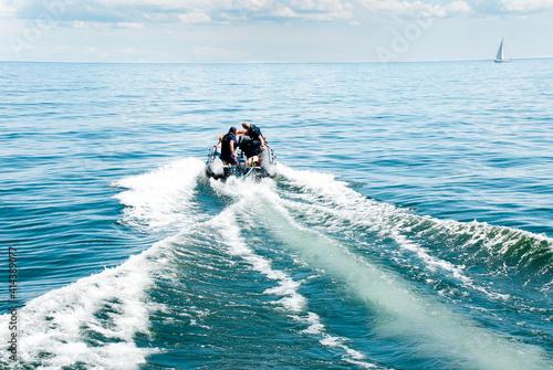 Fototapeta Motorboat on open blue sea