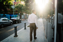 Young Entrepreneur Strolling Down Street And Looking At Reflection