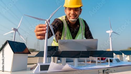 Fotografia, Obraz Foreman is simulating solar cells and wind turbines prior to installation
