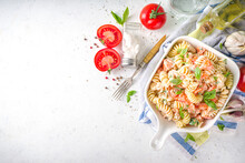 Spring Diet Healthy Vegan Pasta. Italian Fusilli Pasta With Tomatoes, Green Vegetables, Fresh Herbs, Cream Cheese Or Feta, On Dark Table Background Copy Space