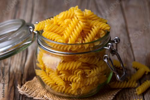 Screw shaped pasta on the wooden background © Esin Deniz