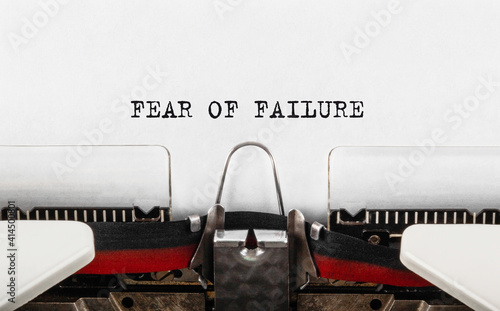 Canvas Text FEAR OF FAILURE typed on retro typewriter