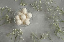 White Ball-shaped Sweets With Coconut Flakes In A Glass Vase With Copy Space. Top View. Selective Foсus