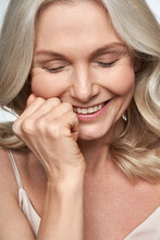 Happy Smiling Pretty Shy 50s Middle Aged Woman Laughing, Cheerful Mature Lady Touching Healthy Soft Face Skin. Anti Age Healthy Skincare Treatment And Cosmetic Ads. Face Close Up View Portrait.