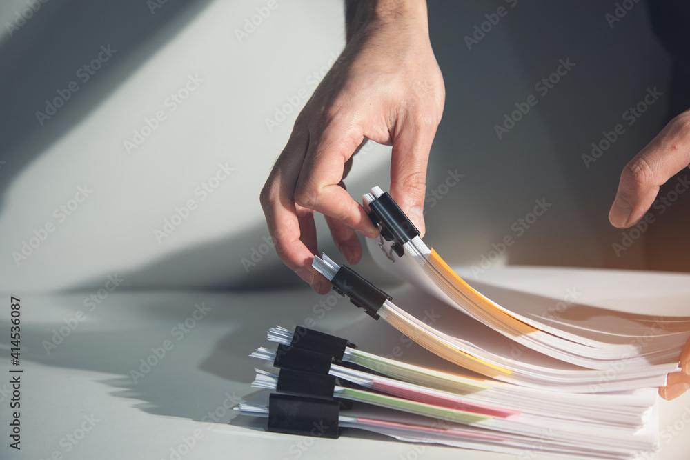 Fototapeta Business man hand document report paper
