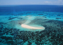 Great Barrier Reef With Anchored Yacht Near Carins, Queensland, Australia - Bird's Eye View.