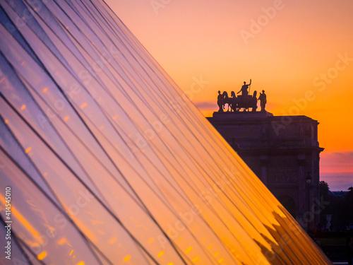 Fototapeta France, Paris, roof of Louvre Museum at sunset.