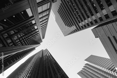 Fototapeta Black and white abstract upward view of downtown skyscrapers in Chicago, Illinoi