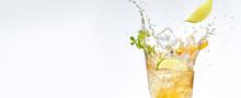 Fresh Fruits Falling Into Cocktail Glass, Splashing On White Background.