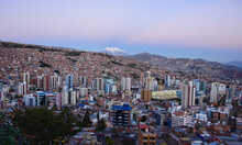 Sunset View With Illimani Towering Over The Density Of La Paz, Bolivia
