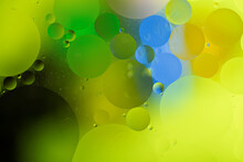 Bright Colorful Oily Drops In Water With Colorful Background, Close-up