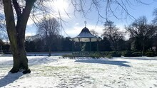 Urban Park With Band Stand, Covered In Snow. Mowbray Park, Sunderland. Panning Shot.