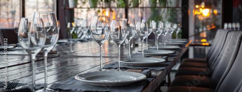 Modern veranda restaurant interior, banquet setting, glasses, plates Poster Mural XXL