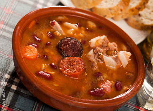 Fototapeta National Spanish dish - beans stewed with chorizo, bacon and sausages obraz