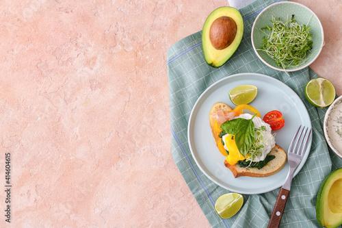 Fotografija Tasty breakfast with florentine egg and fresh vegetables on color background