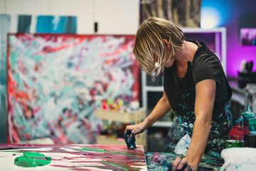Woman artist painting on canvas in workshop studio - Painter work and creative craft concept