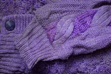 Fabric Texture Of Lilac Wool Knitted Sweater With Dirty Old Sleeve And Button