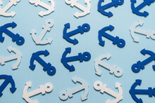 Blue Anchors On A Blue Background.