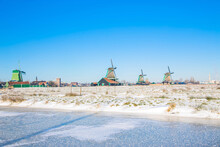Vintage Beautiful Dutch Houses, Old Windmills, Frozen Water In Canals And Rivers.