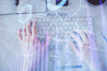 Double exposure of man's hands typing over laptop keyboard and forex chart hologram drawing. Top view. Financial markets concept.